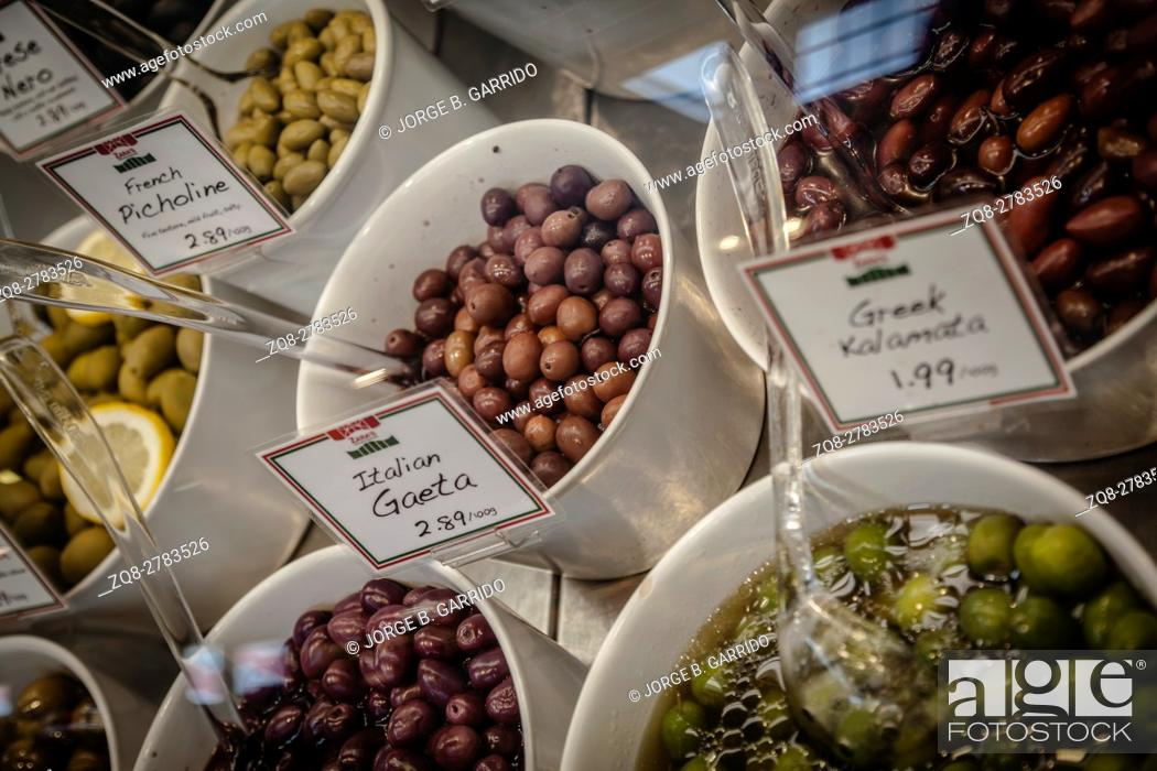 Stock Photo: Mix Olives in variation of Pesto sauce.