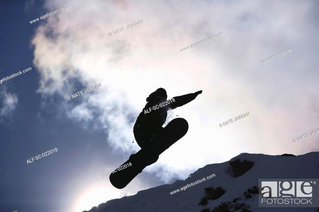 Stock Photo: Snowboarder Flying Through the Air.