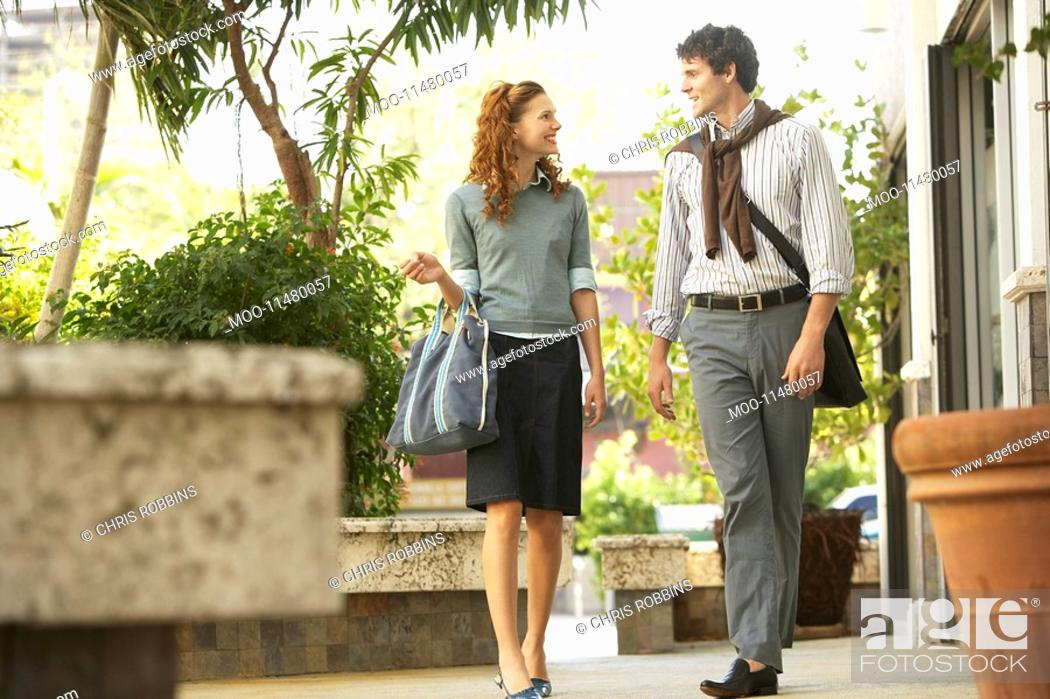 Stock Photo: Young couple walking in courtyard.
