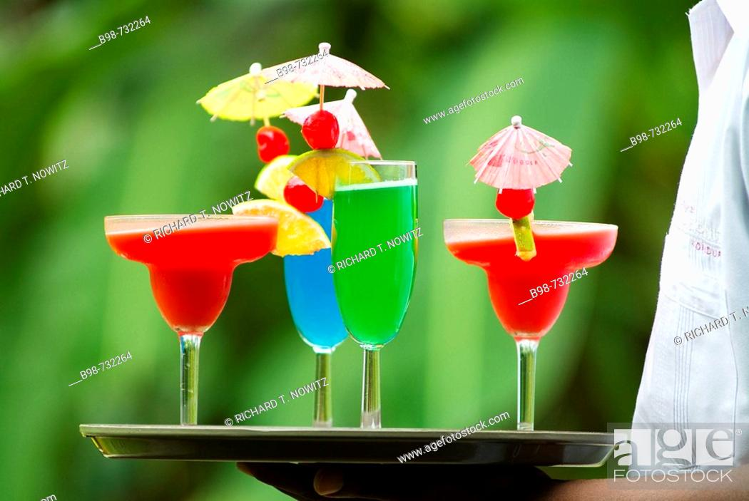 Stock Photo: Person holding a tray of drinks, Pico Bonito Lodge , Honduras.