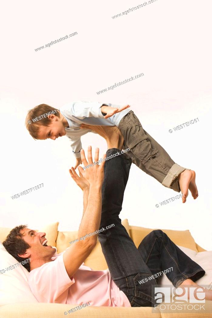 Stock Photo: Father and son 4-5, fooling about.