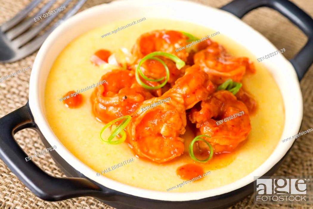 Stock Photo: Spicy Prawns & Polenta - Soft polenta topped with prawns in tomato and chili sauce garnished with spring onion.