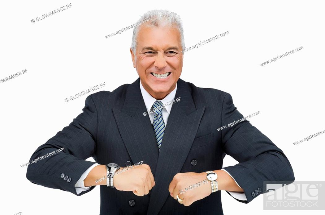 Stock Photo: Close-up of a businessman wearing two wristwatches.