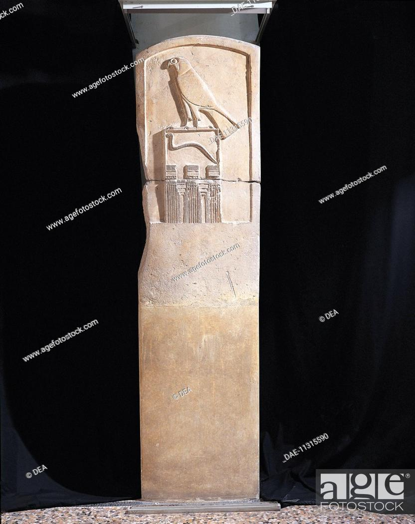 Stock Photo: Egyptian civilization, Old Kingdom. Limestone stele of the Serpent King, with bas-relief depicting falcon god Horus and a cobra, circa 3100 b.C.