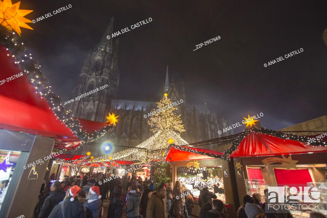 Stock Photo: The larger Christmas markets are held in downtown. The booths near the cathedral are arranged around a huge Christmas tree, Cologne Germany.