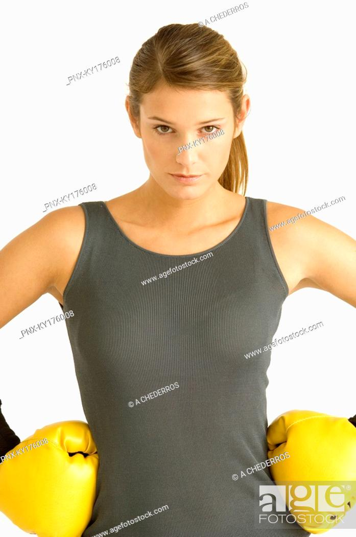 Stock Photo: Portrait of a female boxer with arms akimbo.