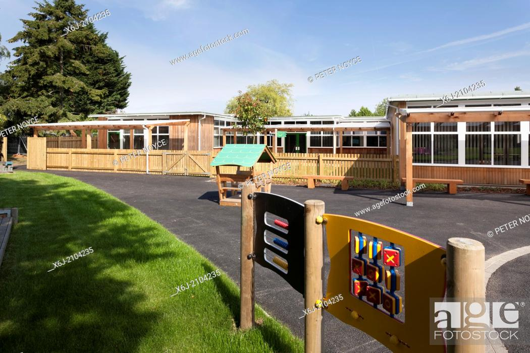 Stock Photo: Infant school playground with outdoor equipment in front of timber clad single story classrooms.