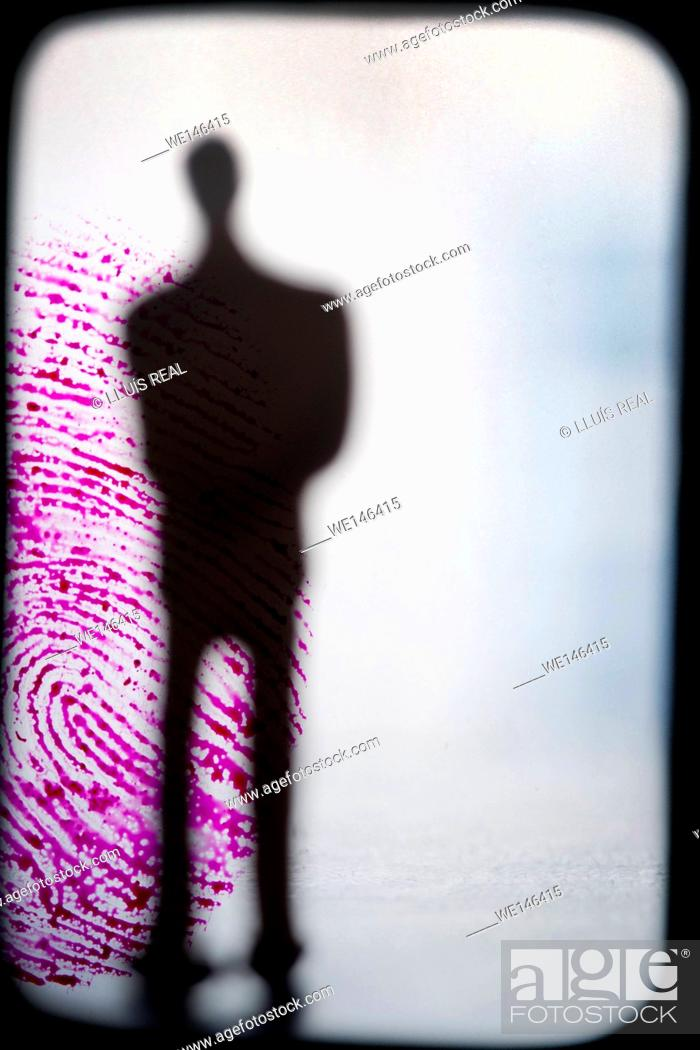 Stock Photo: composicion digital de silueta de un hombre ireconocible y de incognito sobre una huella digital de color, silhouette of a unrecognizable and incognito man on.