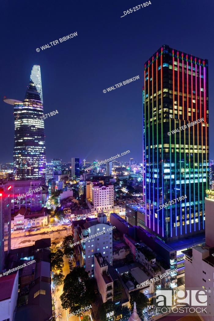 Stock Photo: Vietnam, Ho Chi Minh City, elevated city view with Bitexco Tower and Times Square Building, dusk.