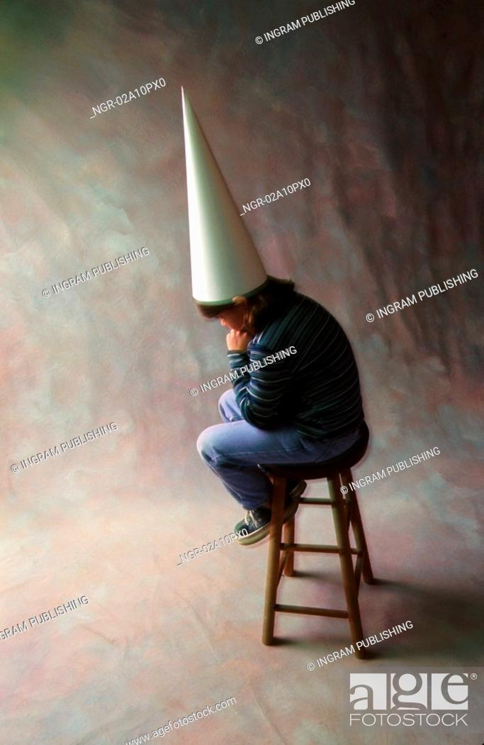 Stock Photo: little boy punished in a corner.
