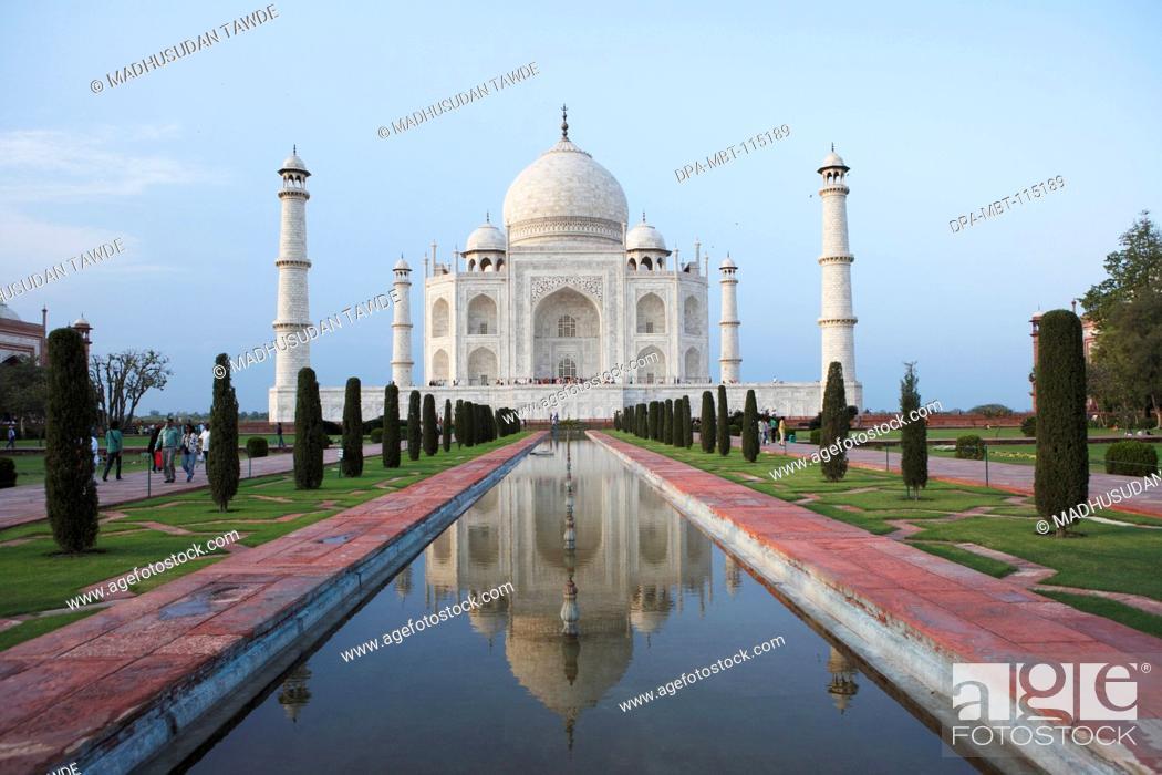 Stock Photo: Reflection of Taj Mahal in pond Seventh Wonders of World on the south bank of Yamuna river , Agra , Uttar Pradesh , India UNESCO World Heritage Site.