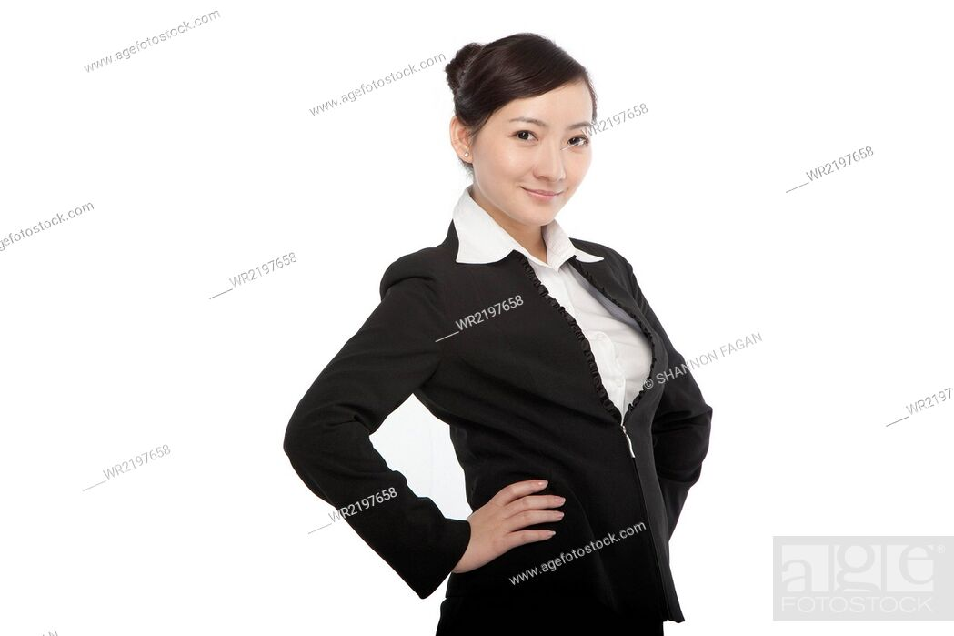 Stock Photo: Portrait of a young woman in a business suit.