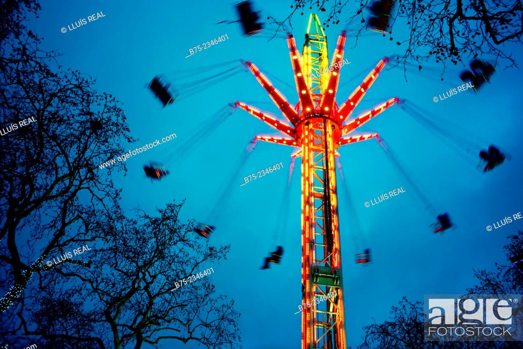 Stock Photo: Swings in a Christmas fair at Leicester Square in the evening, London, England, UK, Europe.