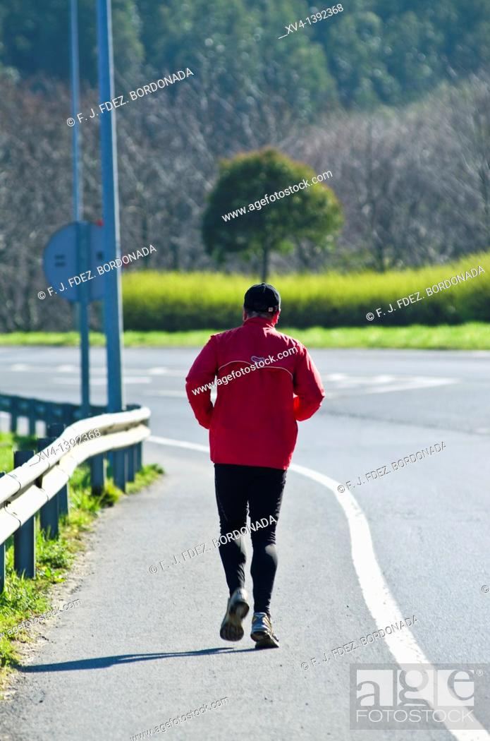 Stock Photo: Retired people running on the road  Bermeo, Biscay, Basque Country, Spain.