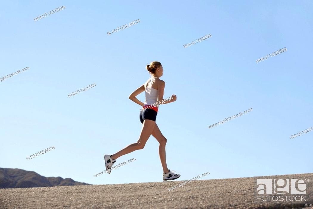 Stock Photo: Young woman jogging.