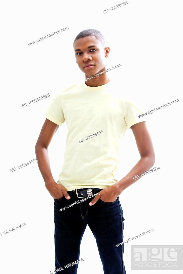 Stock Photo: Casual young African man in yellow shirt and hands in pocket of jeans, isolated.