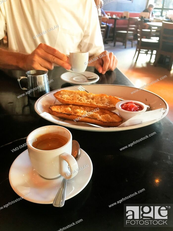 Stock Photo: Spanish breakfast: cup of coffee and bread with olive oil and tomato. Spain.