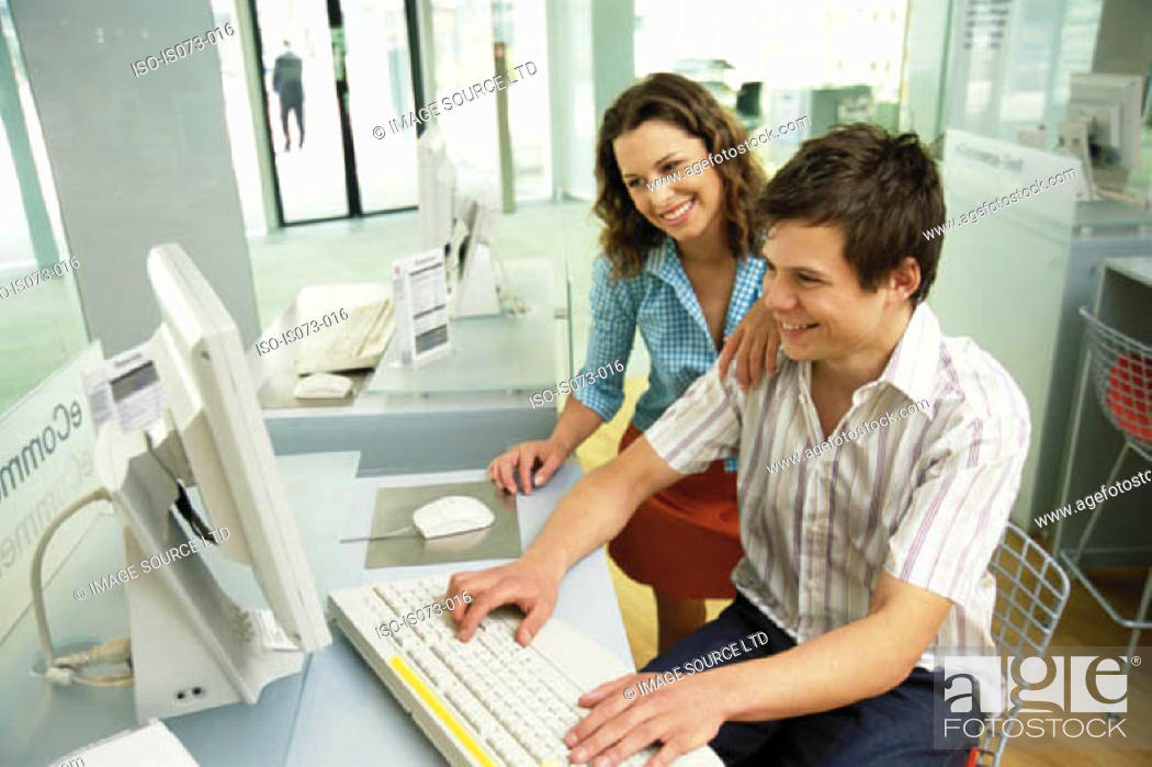 Stock Photo: Couple at computer.