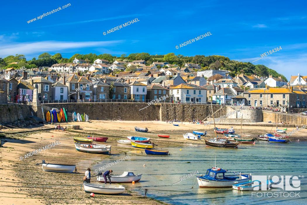 Stock Photo: Small fishing boats in Mousehole harbour Cornwall England GB UK EU Europe.