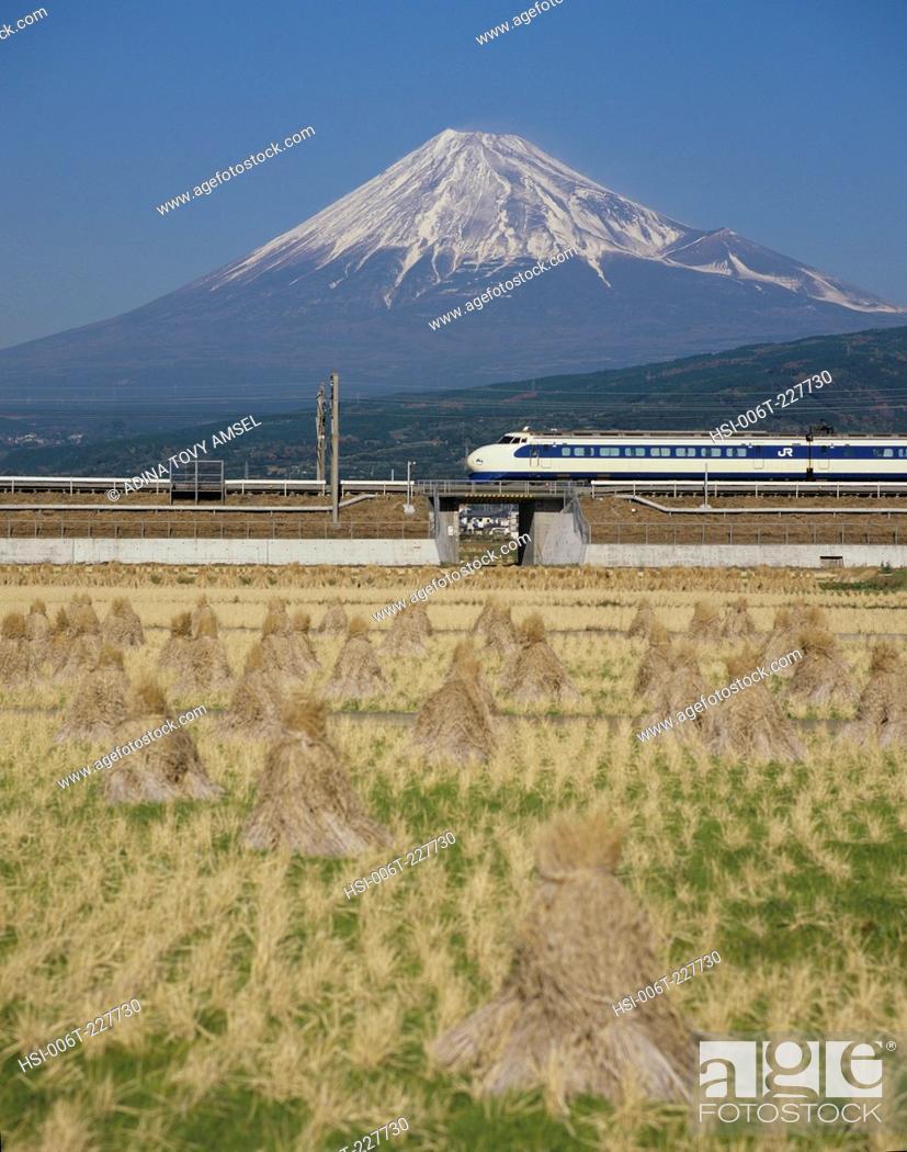 Stock Photo: Japan. Bullet train in front of Mount Fuji.