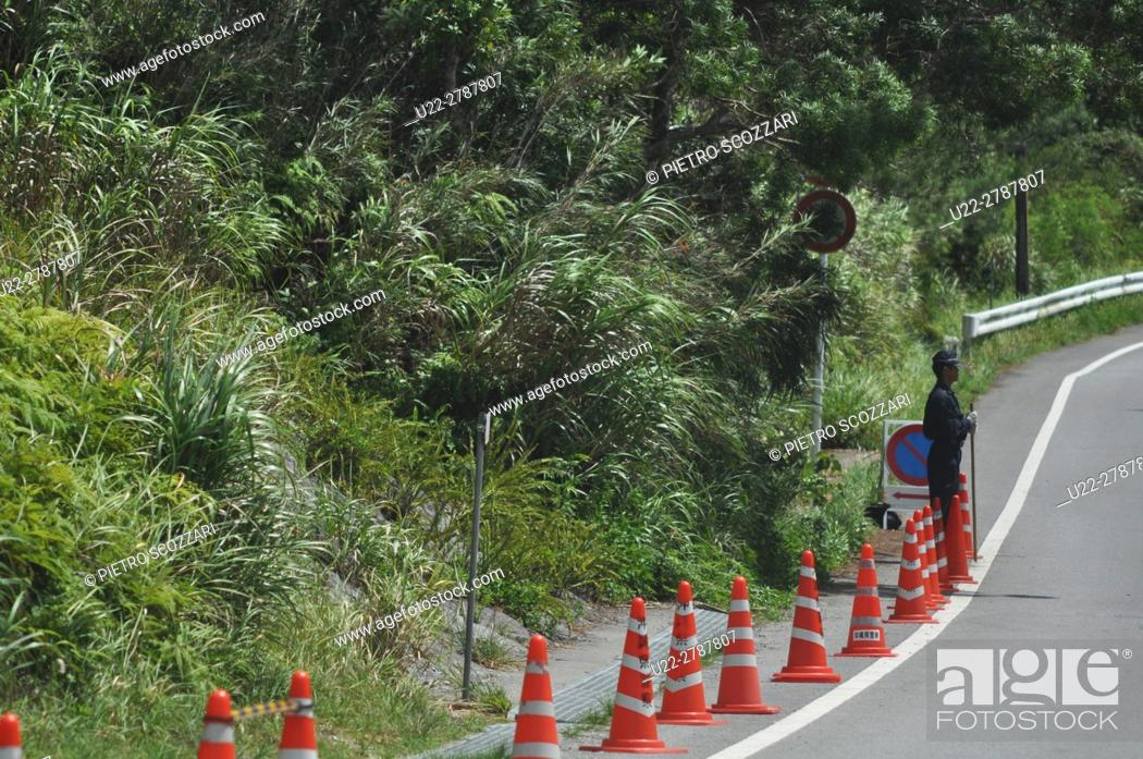 Stock Photo: Takae, Okinawa, Japan: a policeman sent by Tokyo's government to stop protesters against the destruction of the Yanbaru forest to builld an helipad for American.