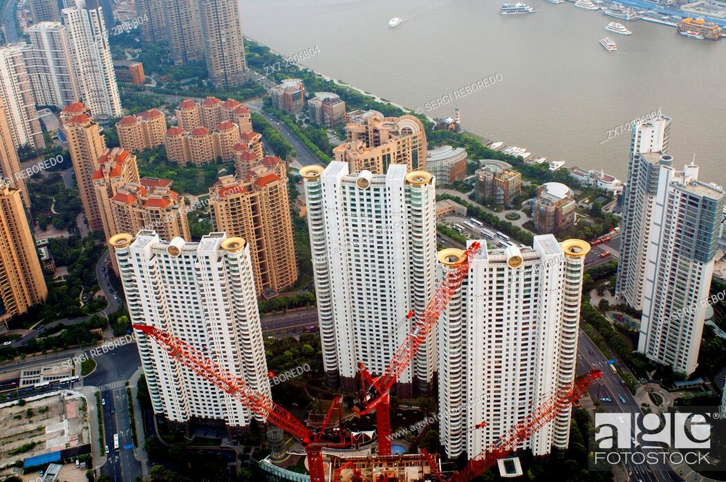 Stock Photo: Under construction. Views from the World Finance Tower, Shanghai, ChinaCityscape, view of Huangpu River, The Bund, Puxi, and financial city, Shanghai, China.