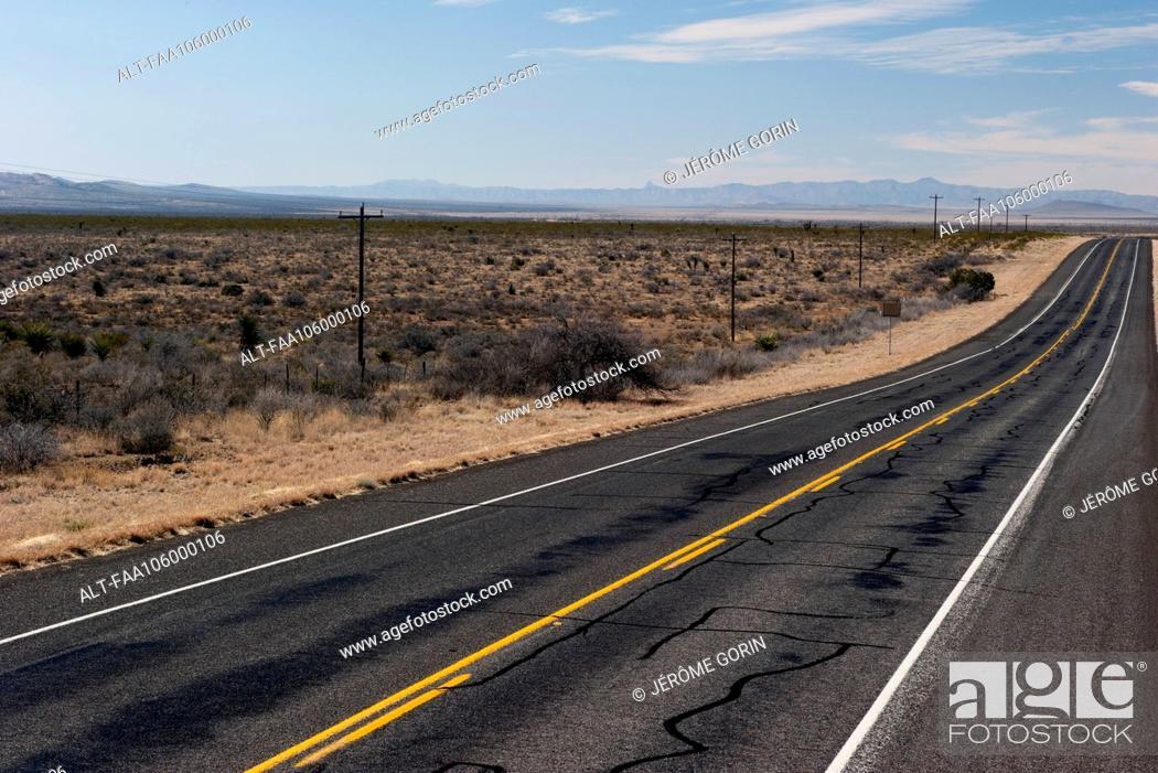 Stock Photo: Highway through desert landscape.