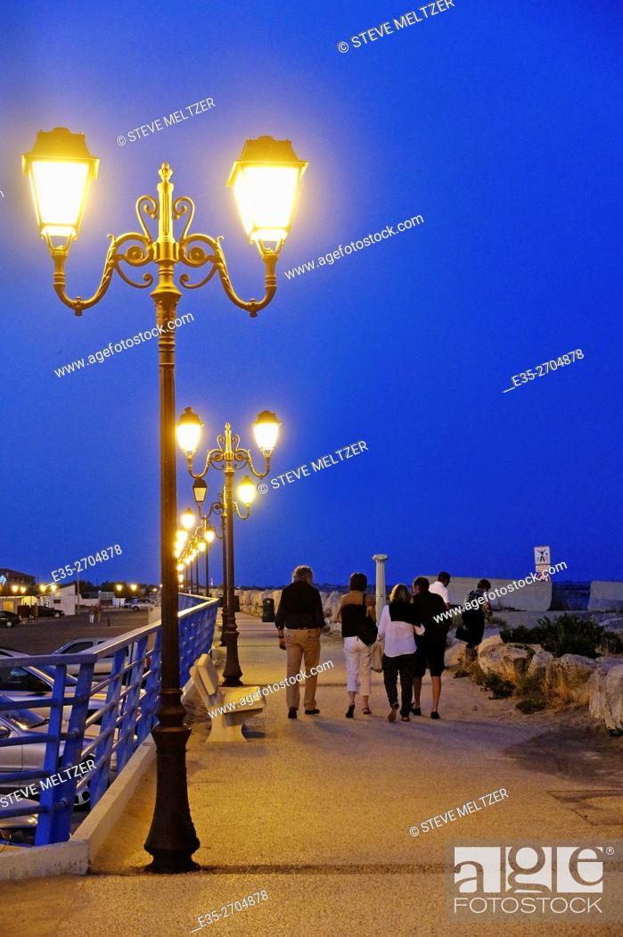 Stock Photo: The seaside boardwalk at Les Saintes Marie de la mer.