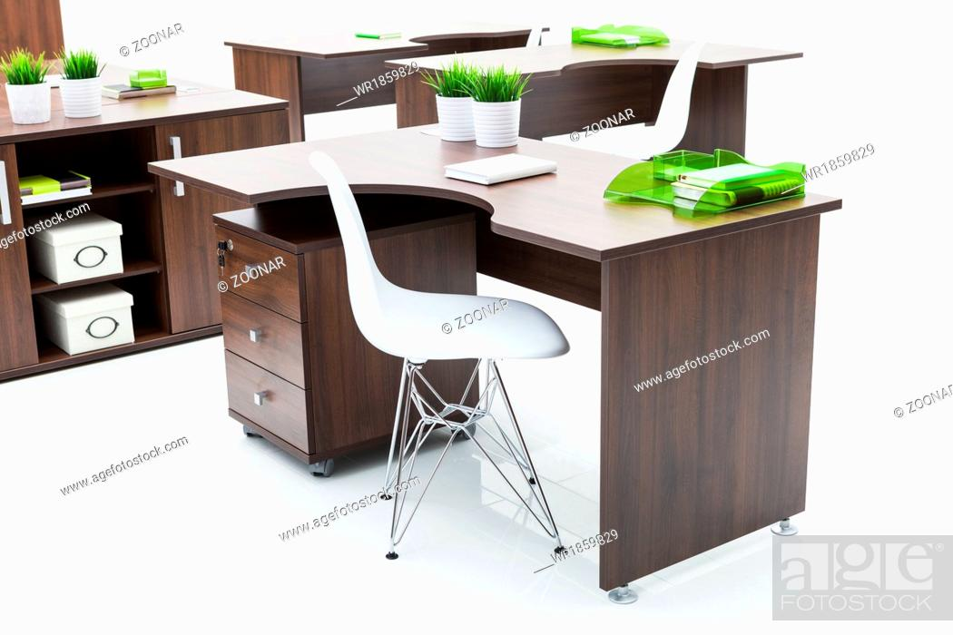 Stock Photo: wooden desks and white chairs.