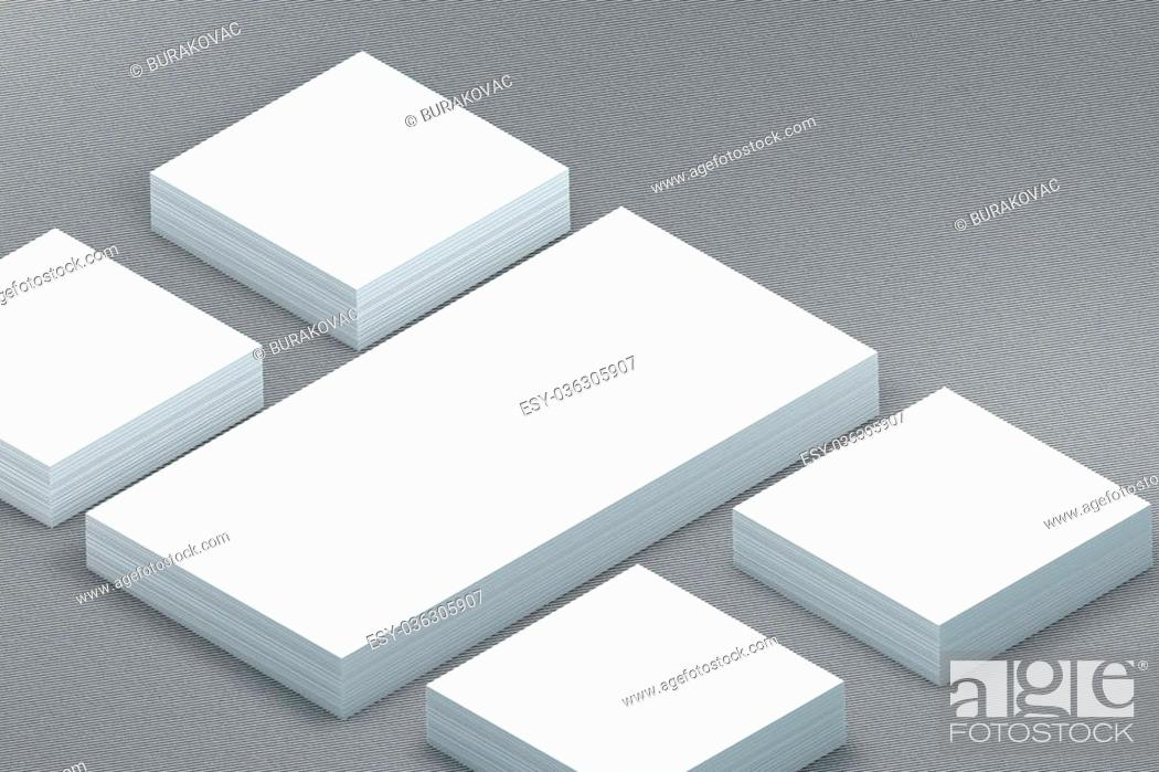 Photo de stock: template to presentation. place for your design. many cards. stacks of paper. greeting cards. flyers. business cards. canvas background. envelope.
