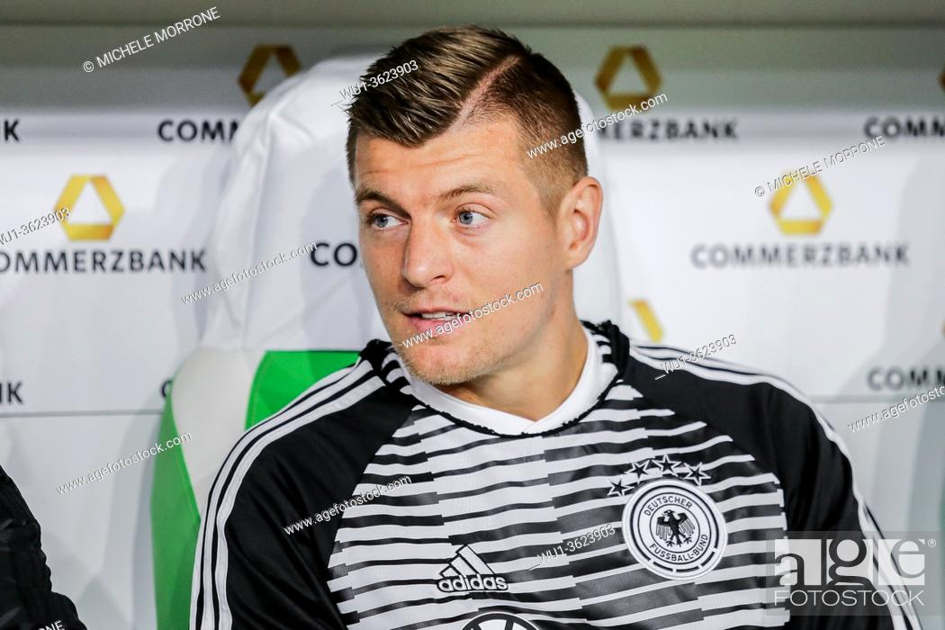 Stock Photo: Wolfsburg, Germany, March 20, 2019: portrait of footballer Toni Kroos sitting on the bench during the international soccer game Germany vs Serbia at Volkswagen.