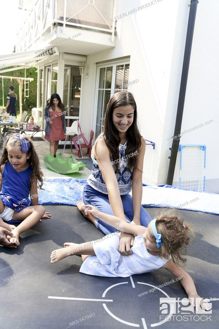 Stock Photo: Children playing on trampoline.
