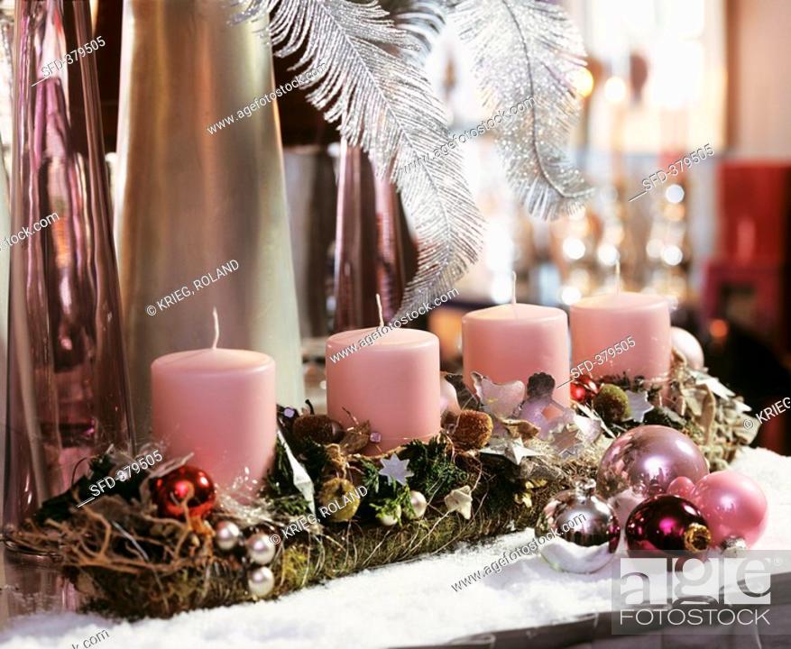 Stock Photo: Advent arrangement with four pink pillar candles.