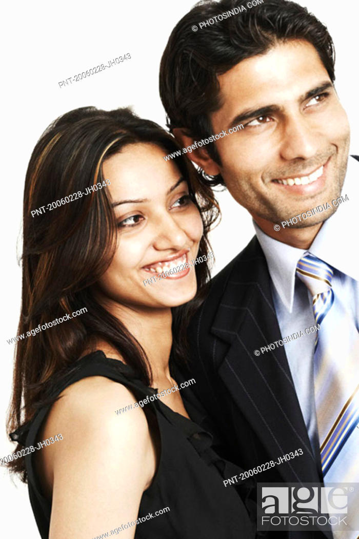 Stock Photo: Close-up of a businessman and a businesswoman smiling.
