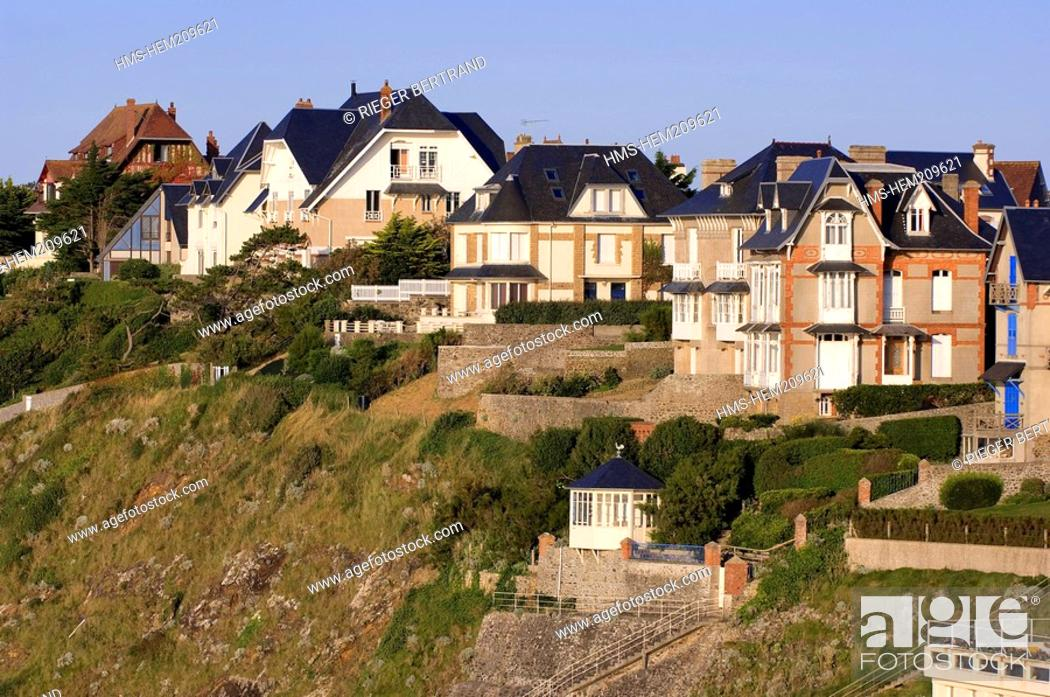 Stock Photo: France, Manche, Granville, villas overhanging the beach and promenade of Plat Gousset, seen from Place de l'Isthme Isthmus Square.