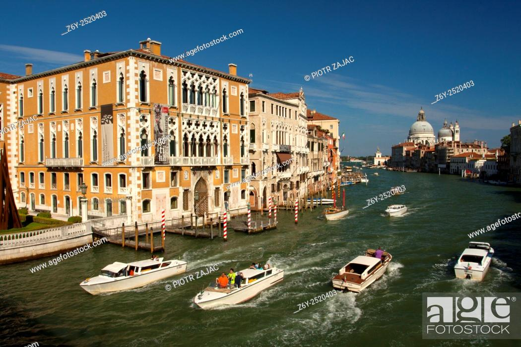 Stock Photo: View of boats on the Grand Canal from Ponte dell'Accademia bridge with Palazzo Cavalli-Franchetti in the foreground and Santa Maria della Salute in the distance.