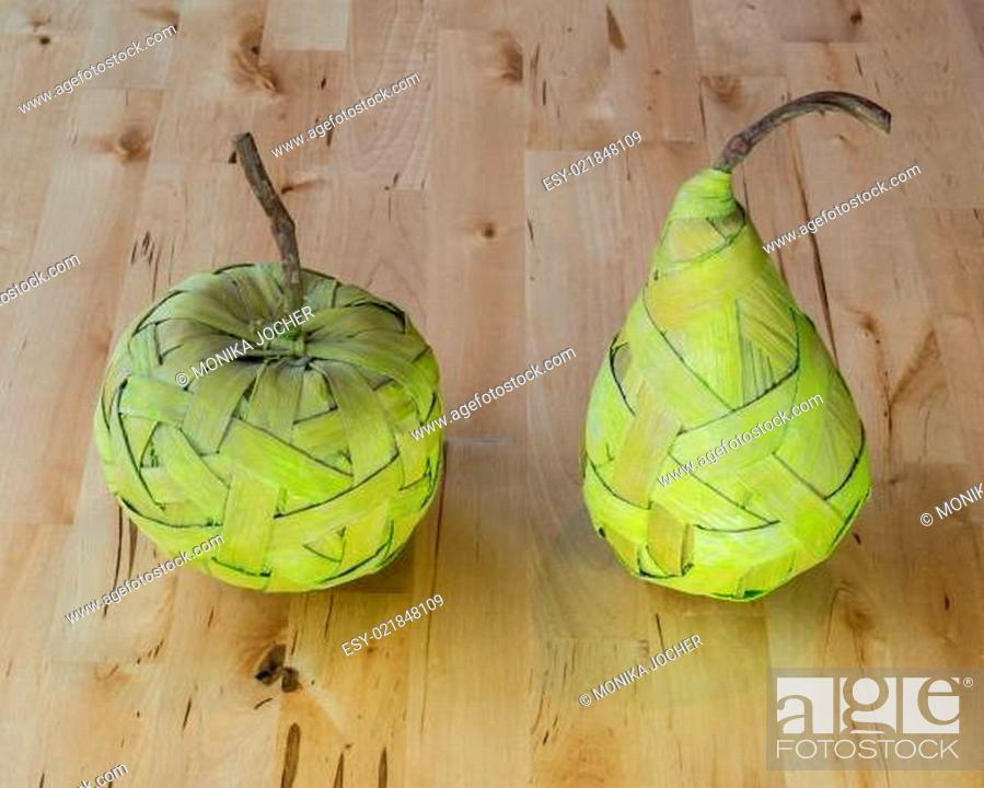 Stock Photo: Fruits made from bast on the table.