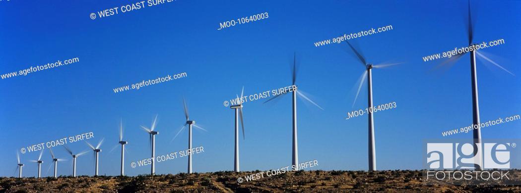 Stock Photo: Wind turbines against blue sky.