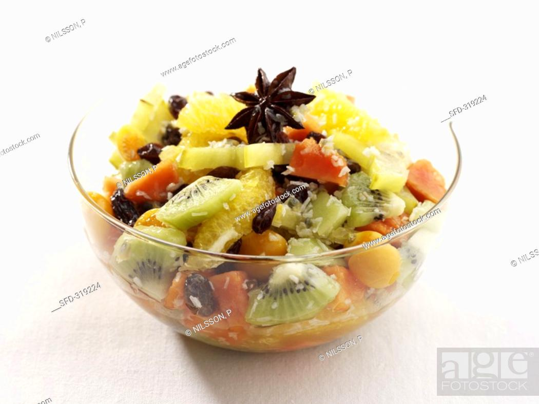 Stock Photo: Exotic fruit salad in a glass bowl.
