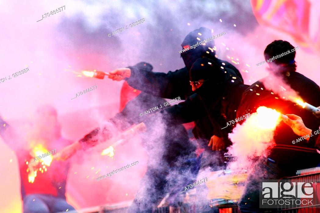 Stock Photo: Football Super League FC Aarau - FC Basel Basler football fan with Rauchpetarden.