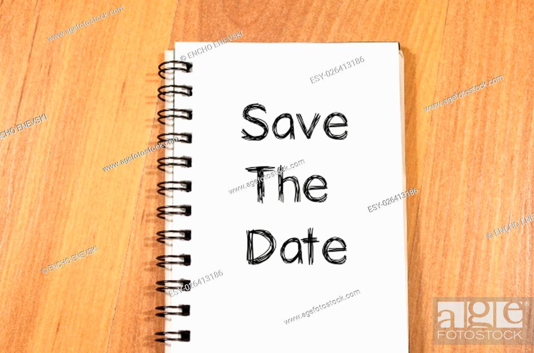 Stock Photo: Save the date text concept write on notebook.