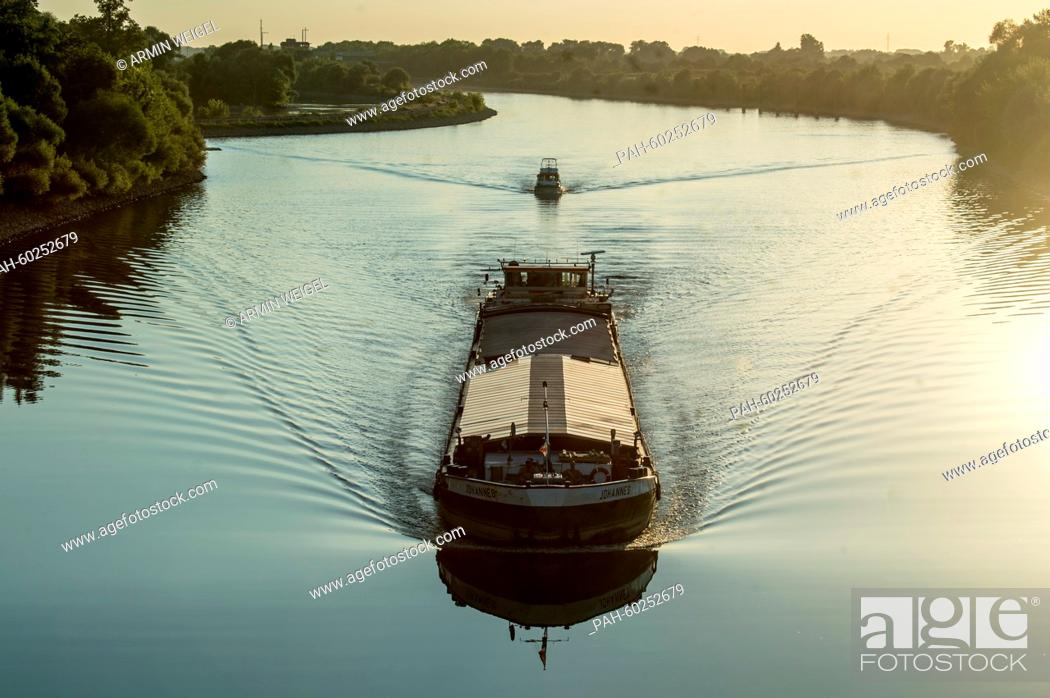 Stock Photo: Boats on the Danube river at evening light in Straubing, Germany, 21 July 2015. Photo:Armin Weigel/dpa | usage worldwide. - Straubing/Bavaria/Germany.