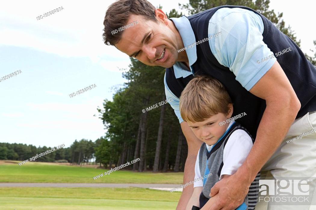 Stock Photo: Father teaching his son golf.