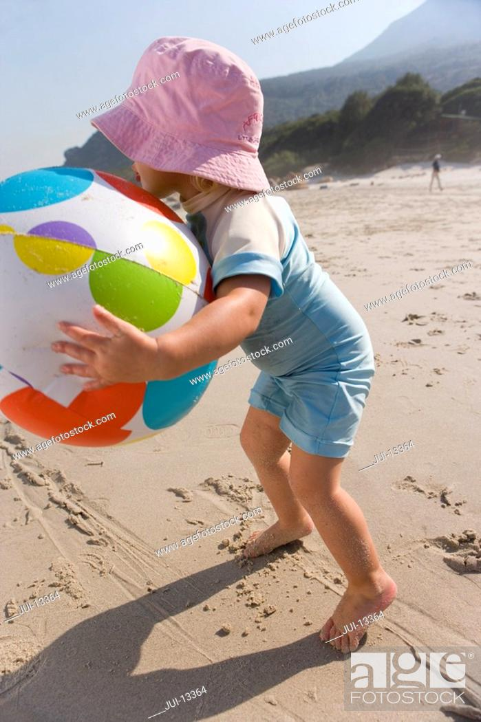 Stock Photo: Girl 1-3 playing with ball on beach.