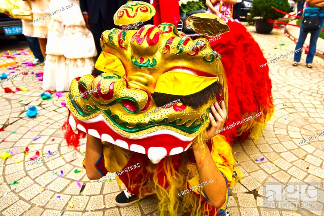 Stock Photo: Person in Chinese dragon costume, Qingdao, Shandong Province, China.