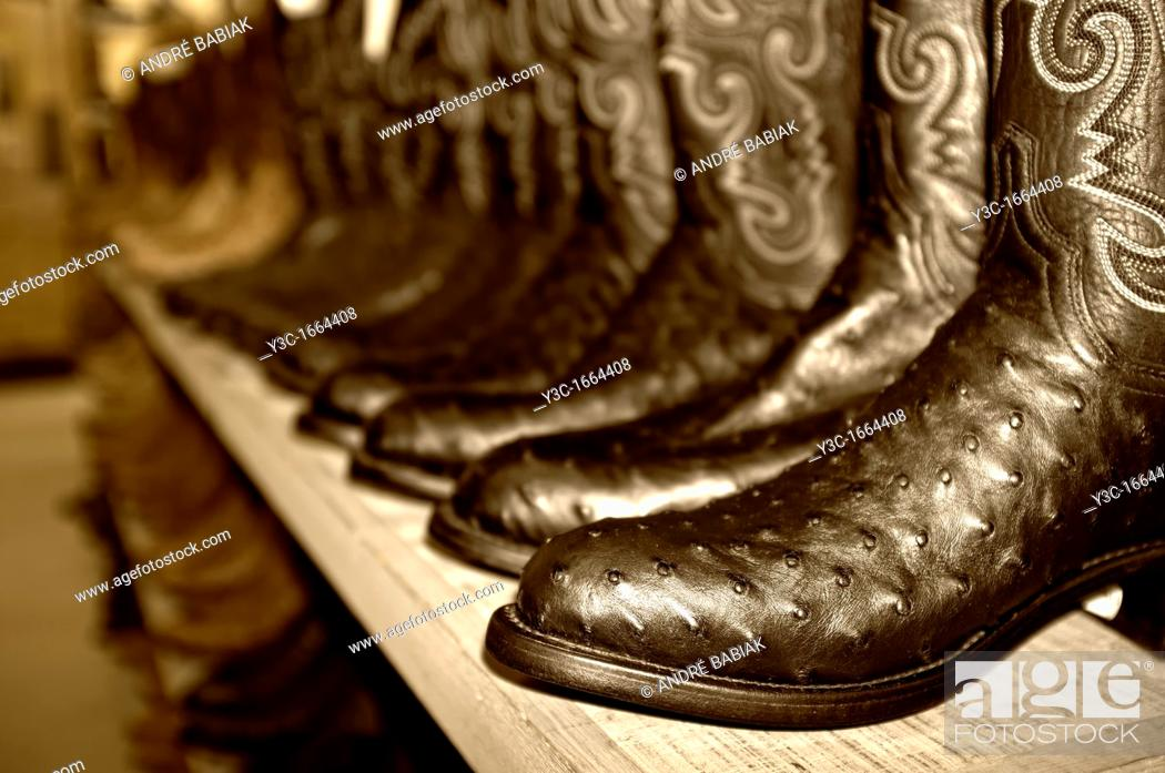 Stock Photo: Western Boots on sales display in western outfitter store.