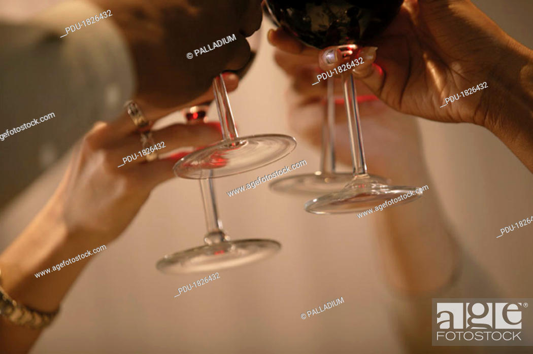 Stock Photo: People raising wine glasses.