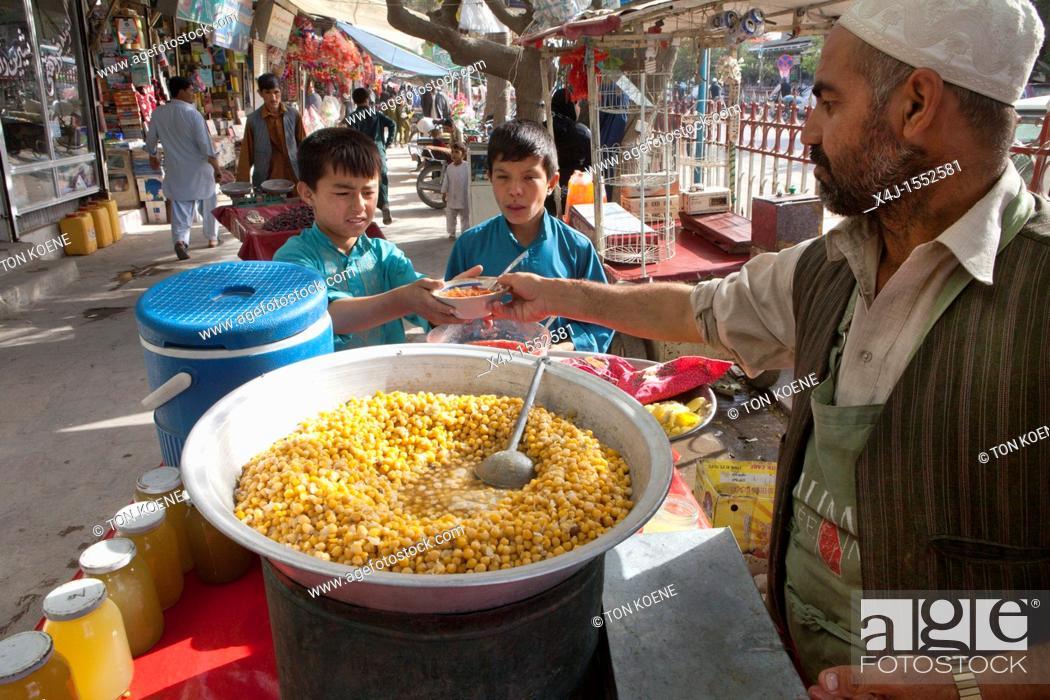 Stock Photo: Bazaar in downtown Kunduz city, Afghanistan.
