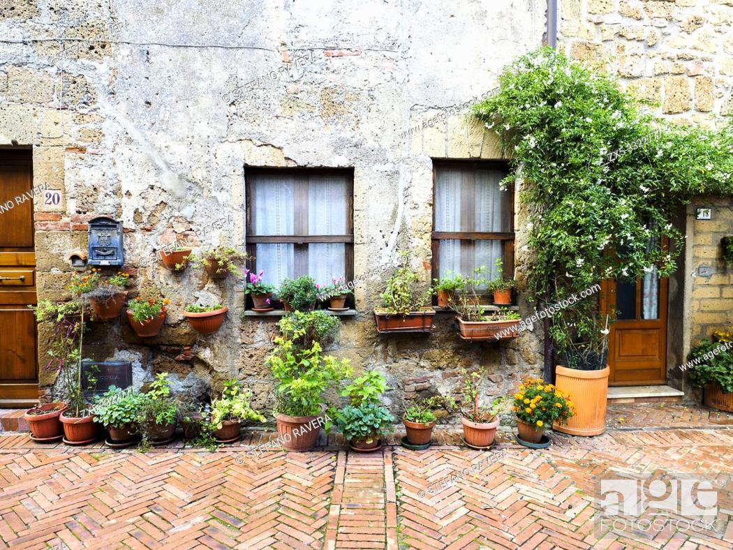 Stock Photo: Stone house facade in the town of Sovana - Tuscany, Italy.