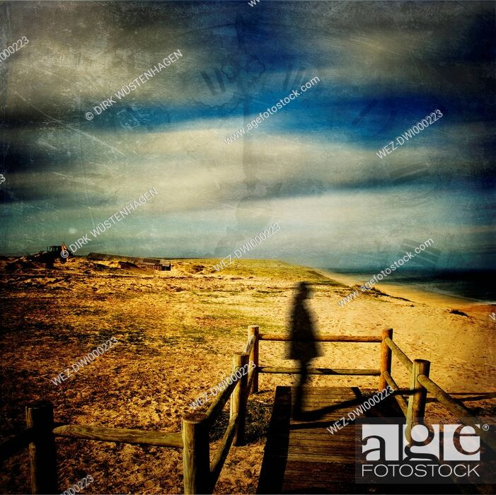 Imagen: France, Contis-Plage, Silhouette of a man on wooden boardwalk.
